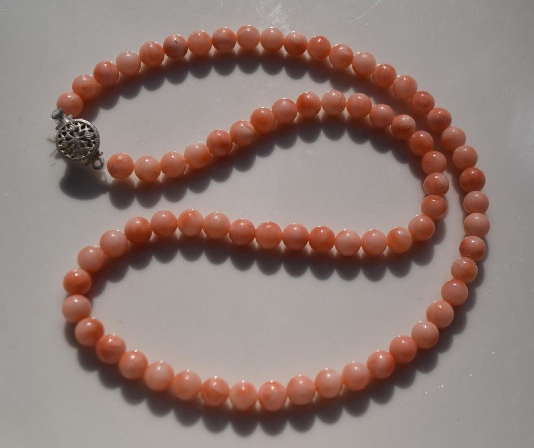 A PINK CORAL NECKLACE