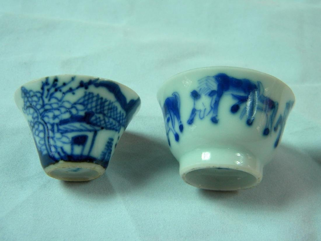 PAIR OF BLUE AND WHITE LIQUOR CUPS