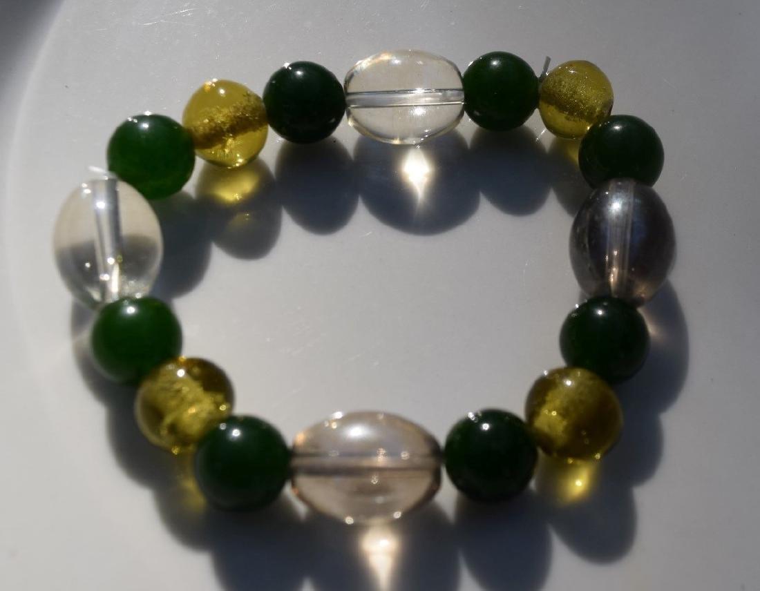 A GREEN JADE BEAD BRACELET