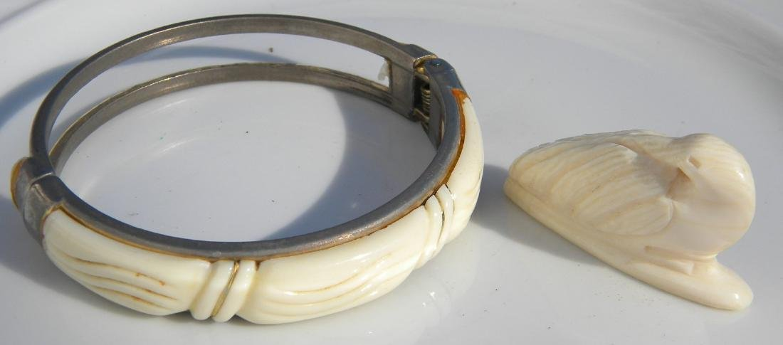 Pair of Carved Bracelet and Bird Statue
