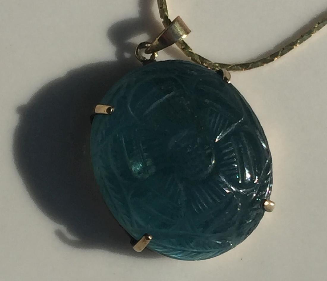 A 14K Gold Blue Tourmaline Pendant