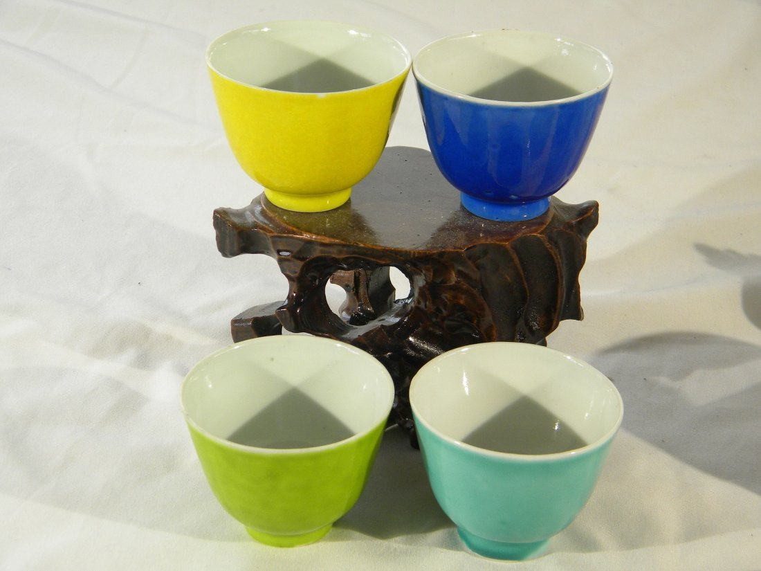 FOUR CHINESE ANTIQUE BLUE YELLOW AND GREEN GLAZED CUPS,