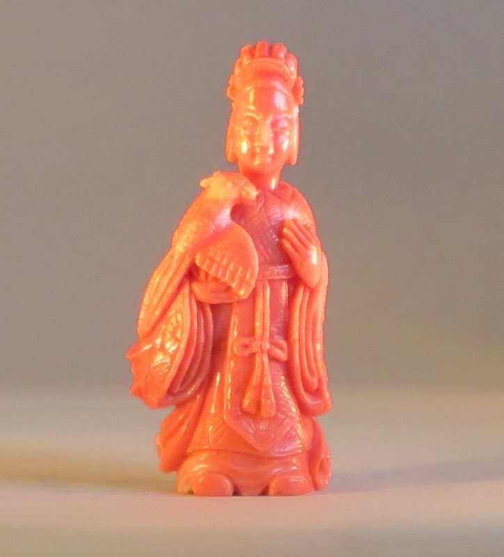 Antique pink coral snuff bottle of a lady with pheonix