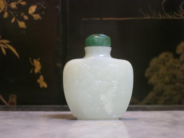 carved white jade snuff bottle