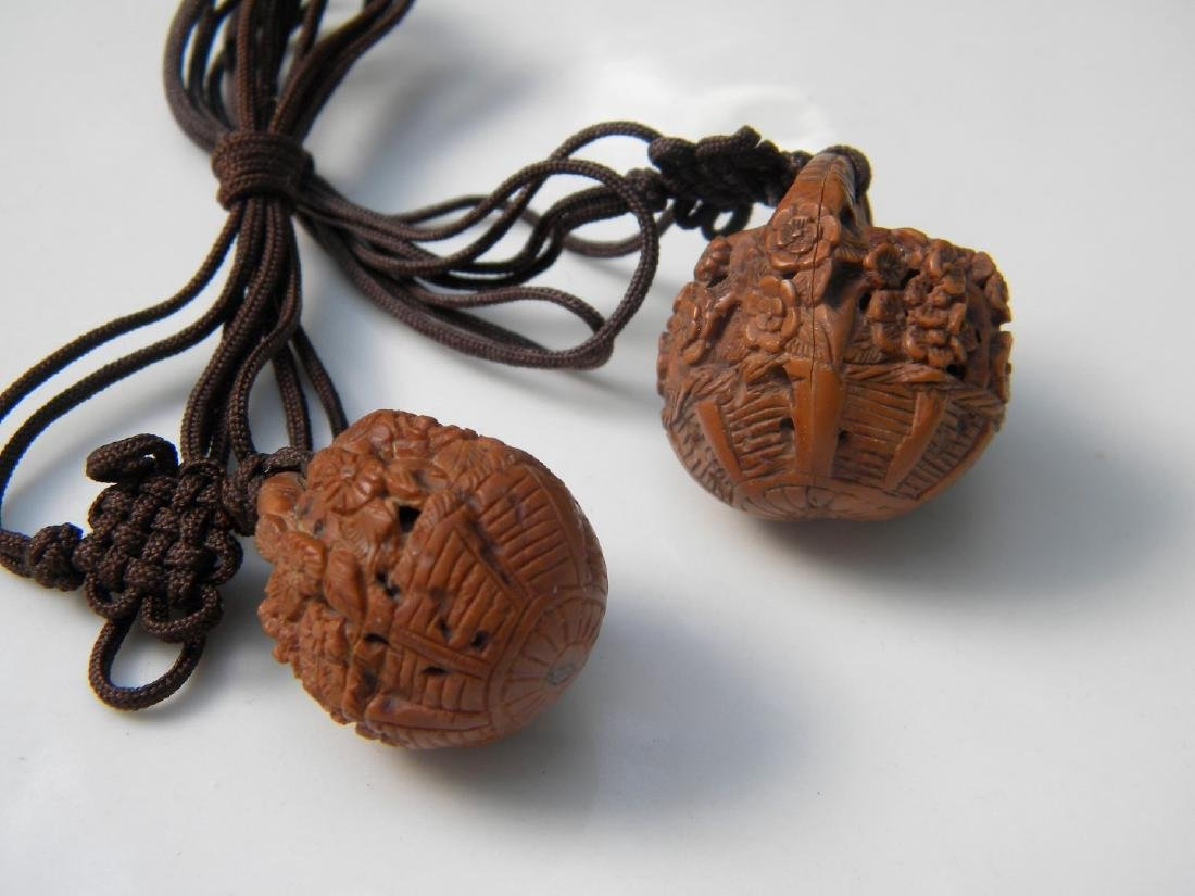 Pair of Antique Chinese Carved Nut Pendants