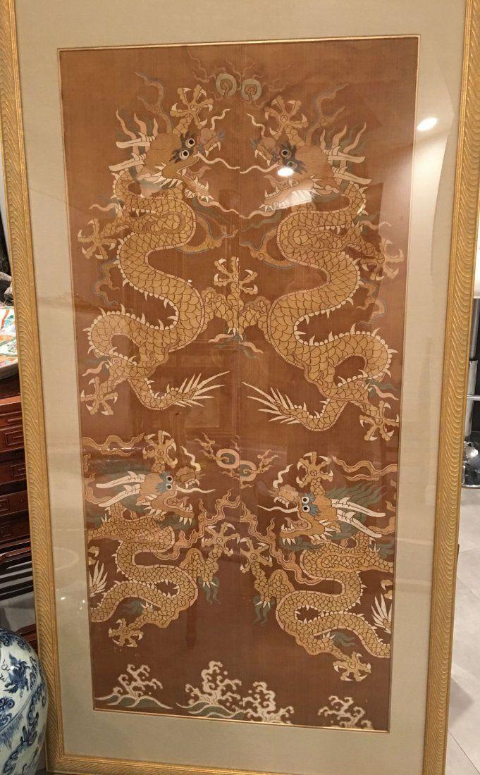 A Qing Dynasty silk woven dragon framed