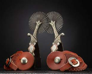 Showy pair of two piece double mounted Spurs by noted