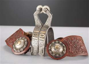 Fancy pair of single mounted Spurs with engraved
