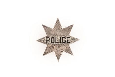 "Police Badge, 8-point star, 1 1/2"" tall. GEORGE JACKSON"