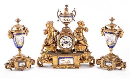 Three piece Sevres French Clock Set. Clock measures 14