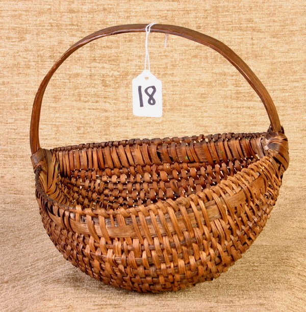 18: Early Half Wall Basket with Carved Handle.  Estimat