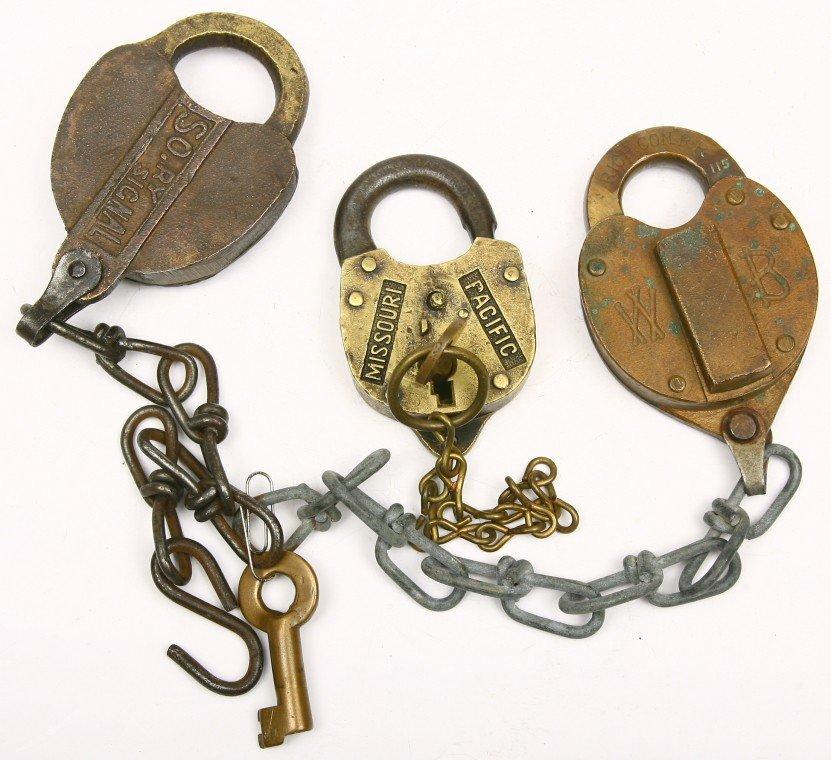 622: Group of 3 brass Railroad locks: 1 heart shaped RI
