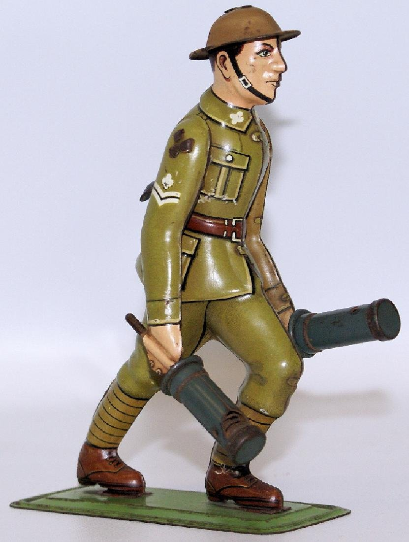 EXTREMELY WWII Tin German Soldier Carrying 2 Grenades,