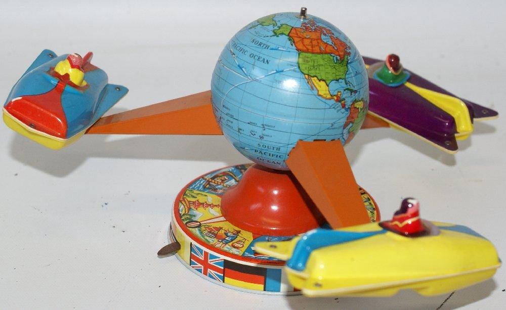 Tin Windup Schopper #523 AROUND THE WORLD Rotating - 2
