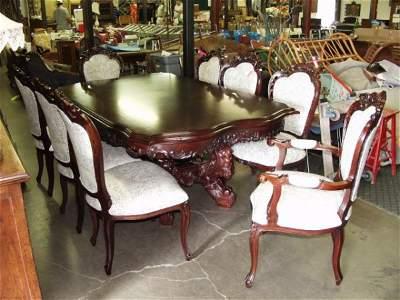 647: Heavy Carved Mahogany Table & 8 Chairs