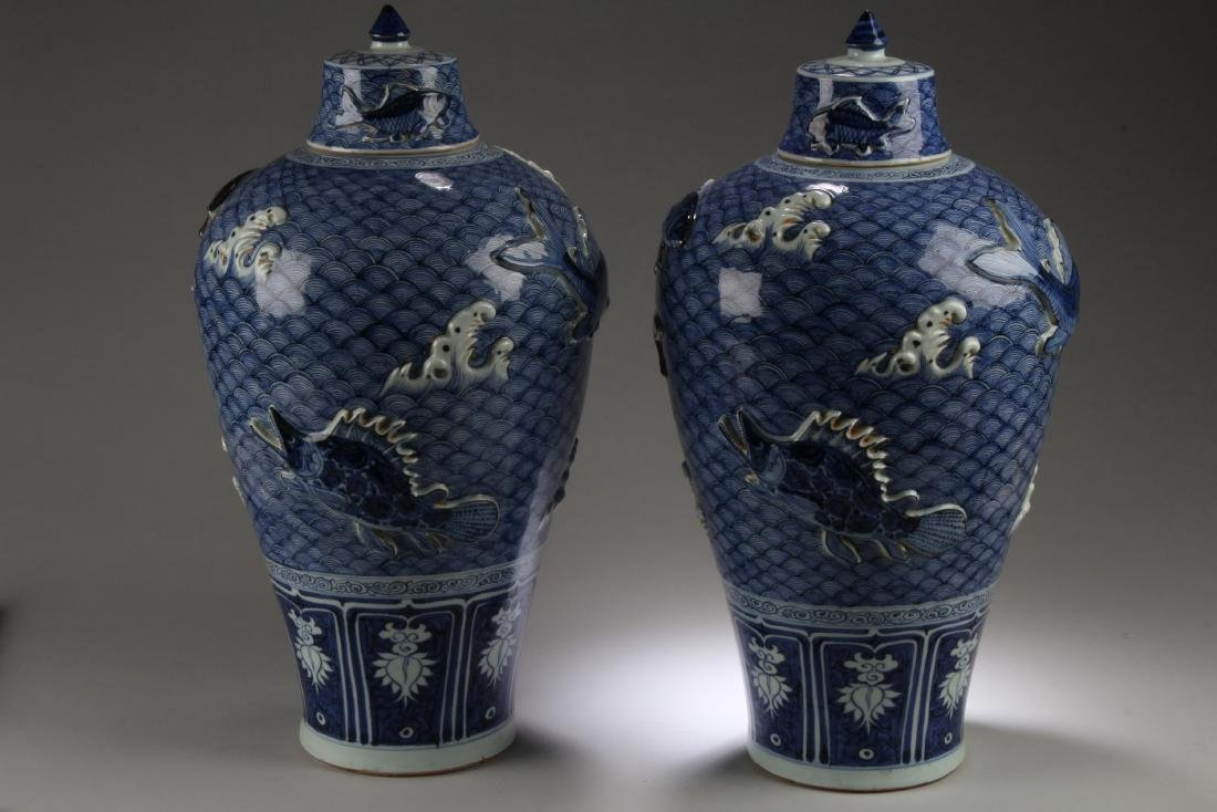 A Pair of Chinese Blue & White Porcelain Vases with Lid