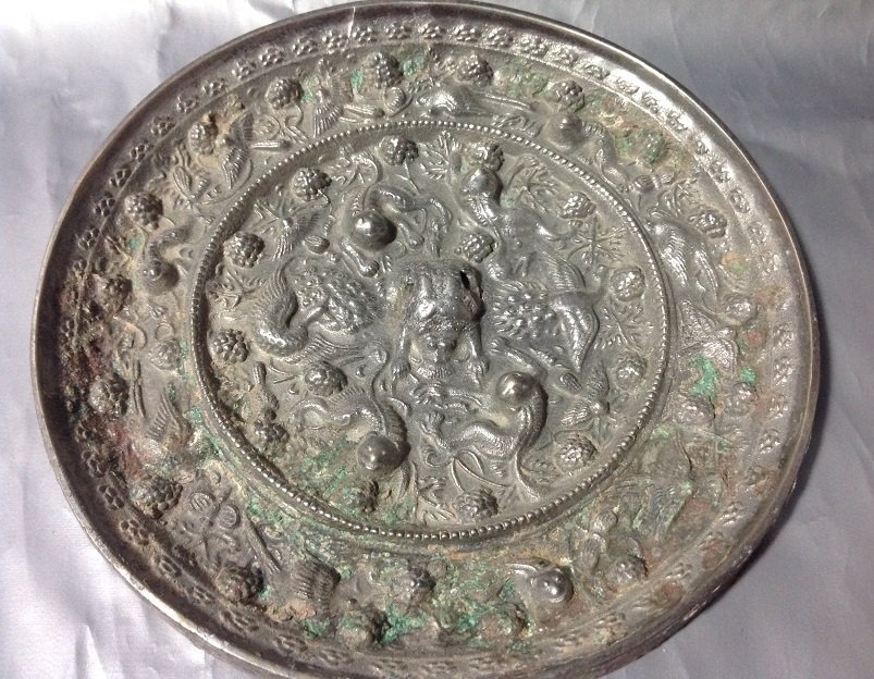 Antique Bronze mirror with silver covered