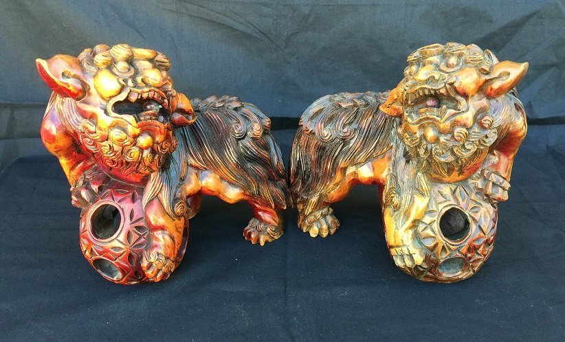 PAIR OF ANTIQUE HUANGYANG WOOD LION