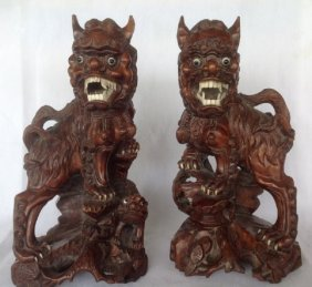 Pair of Qing Dynasty Carved Huangyang Wood Lion