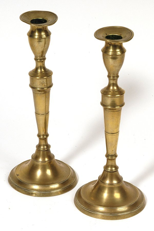 23: PAIR OF EARLY BRASS PUSH-UP CANDLESTICKS