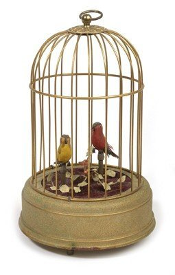 7A: TWO SINGING BIRDS IN BRASS CAGE