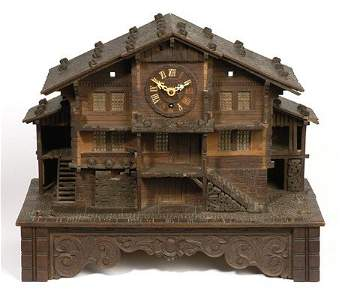 94: SWISS CHALET WITH CLOCK