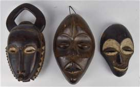 Three Early African Wood Masks