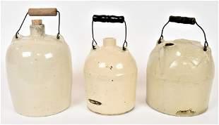 Three Stoneware Whiskey Jugs