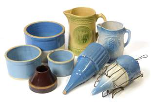 Eight Pieces of Stoneware, Blue Wall Pockets Plus