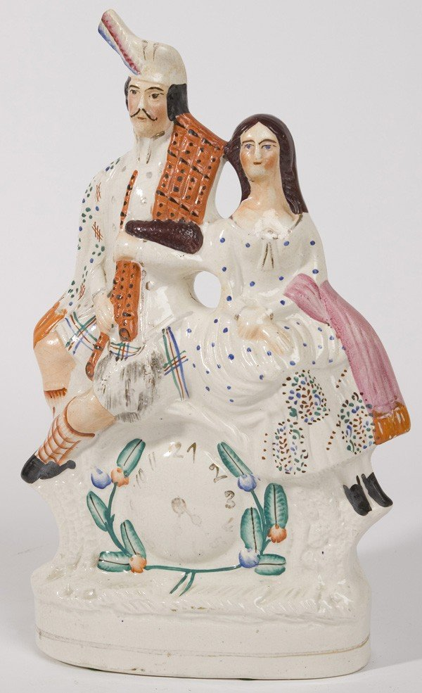 15: STAFFORDSHIRE FIGURE OF ROYAL COUPLE WITH CLOCK