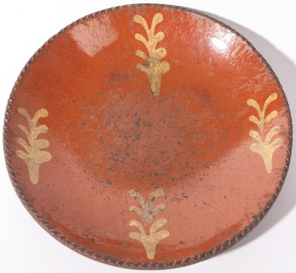 17: SLIP DECORATED REDWARE PIE PLATE