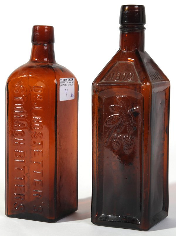 TWO AMBER BITTERS BOTTLES