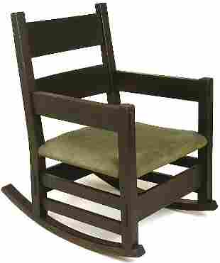 Early Gustav Stickley Thorden arm rocker with two ho