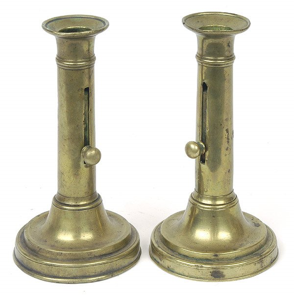 11: PAIR OF EARLY BRASS PUSH-UP CANDLESTICKS