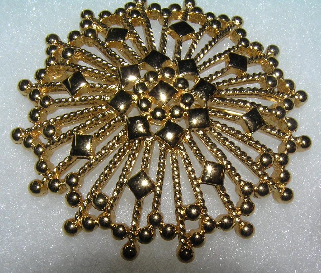 High quality gold toned pin signed Monet