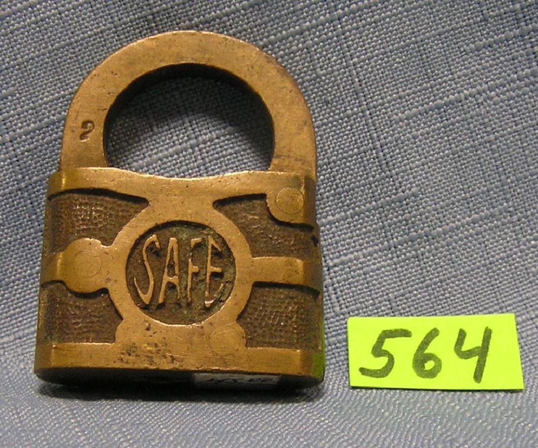 Antique brass pad lock named SAFE