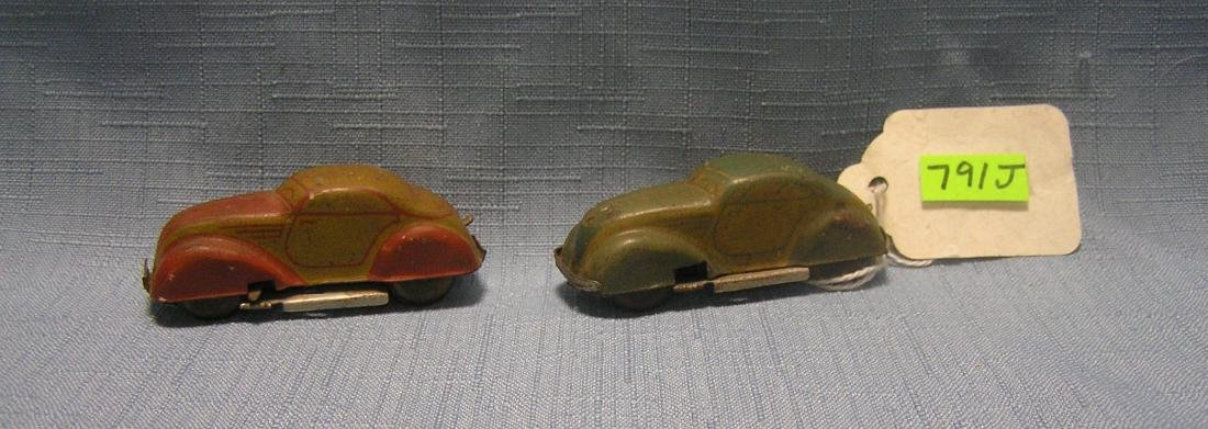 Pair of US Zone Germany tin windup toy cars
