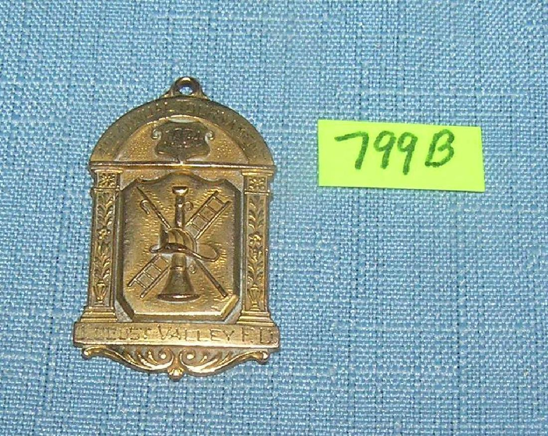 Antique first place ladder climbing award badge