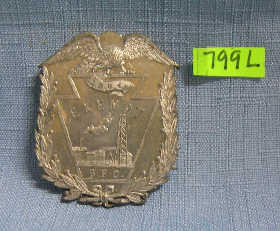 Antique fireman's exempt shield dated 1884