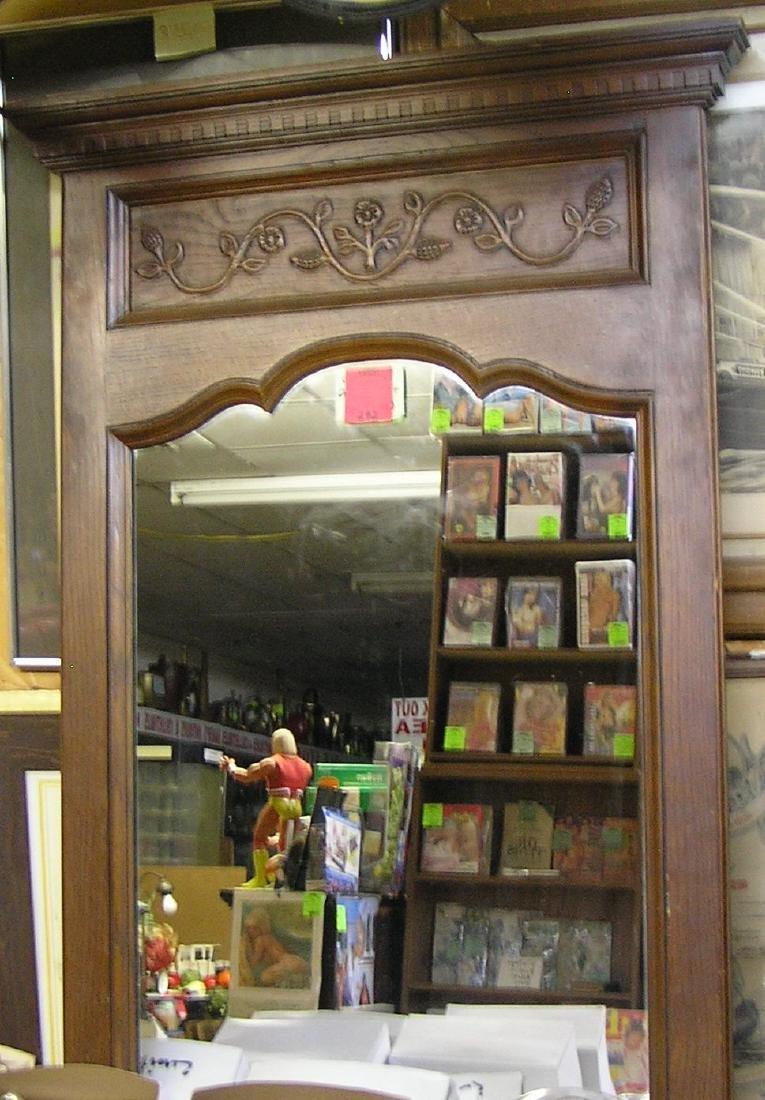 Vintage carved oak wall mirror