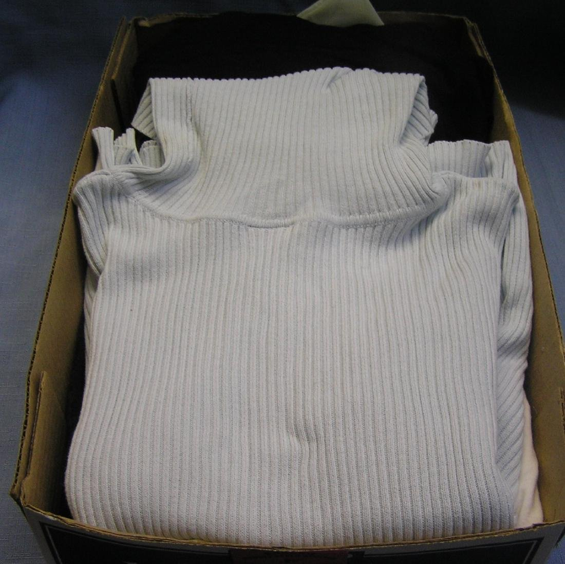 Box of quality modern shirts and turtlenecks