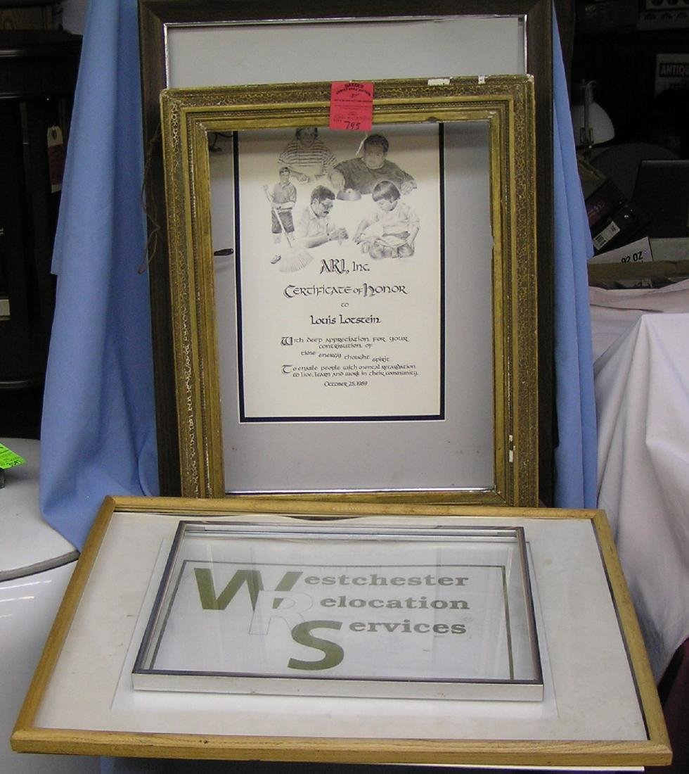 Group of four antique and modern frames