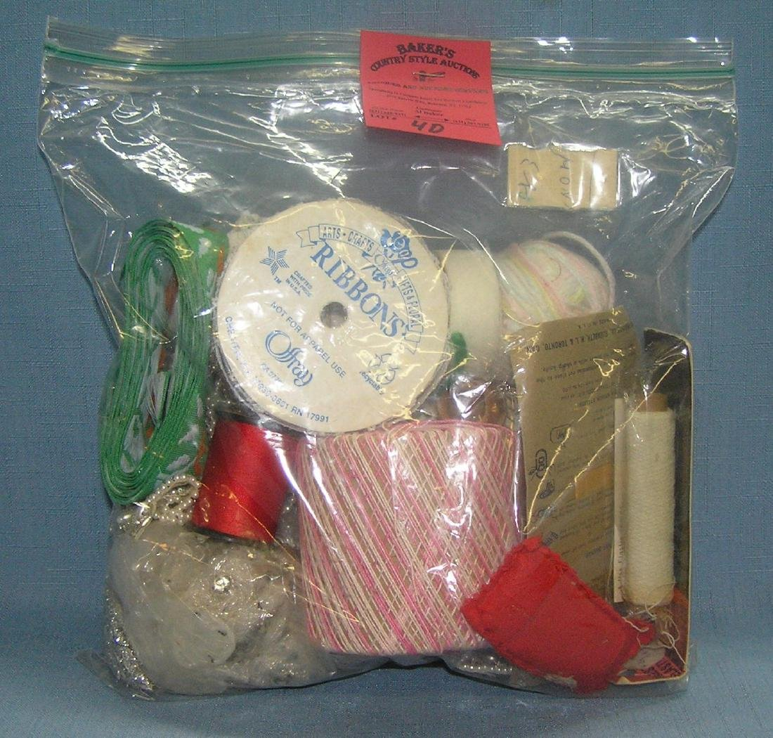 Bag of vintage sewing collectibles