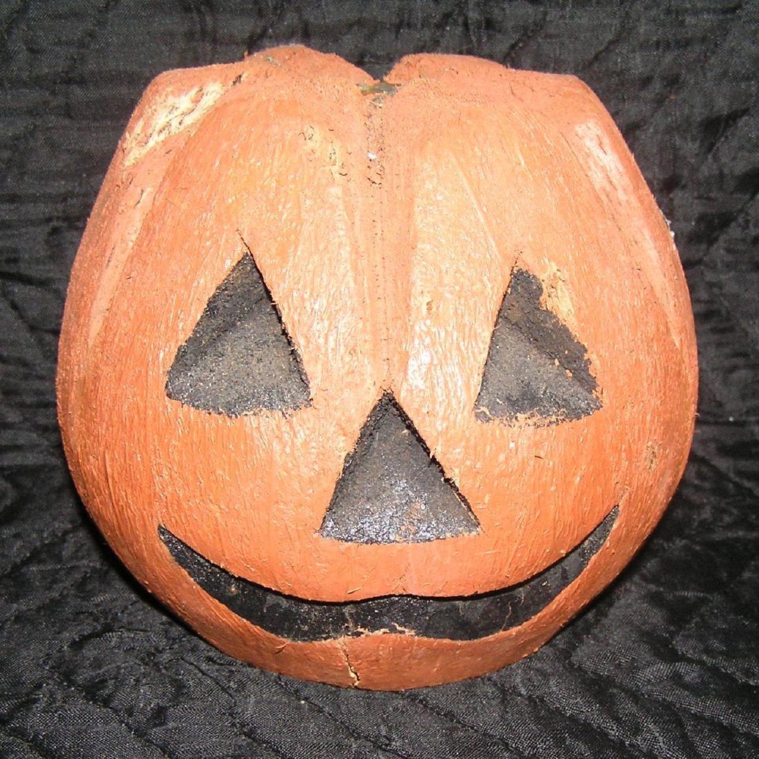 Vintage Jack O Lantern carved from an old coconut