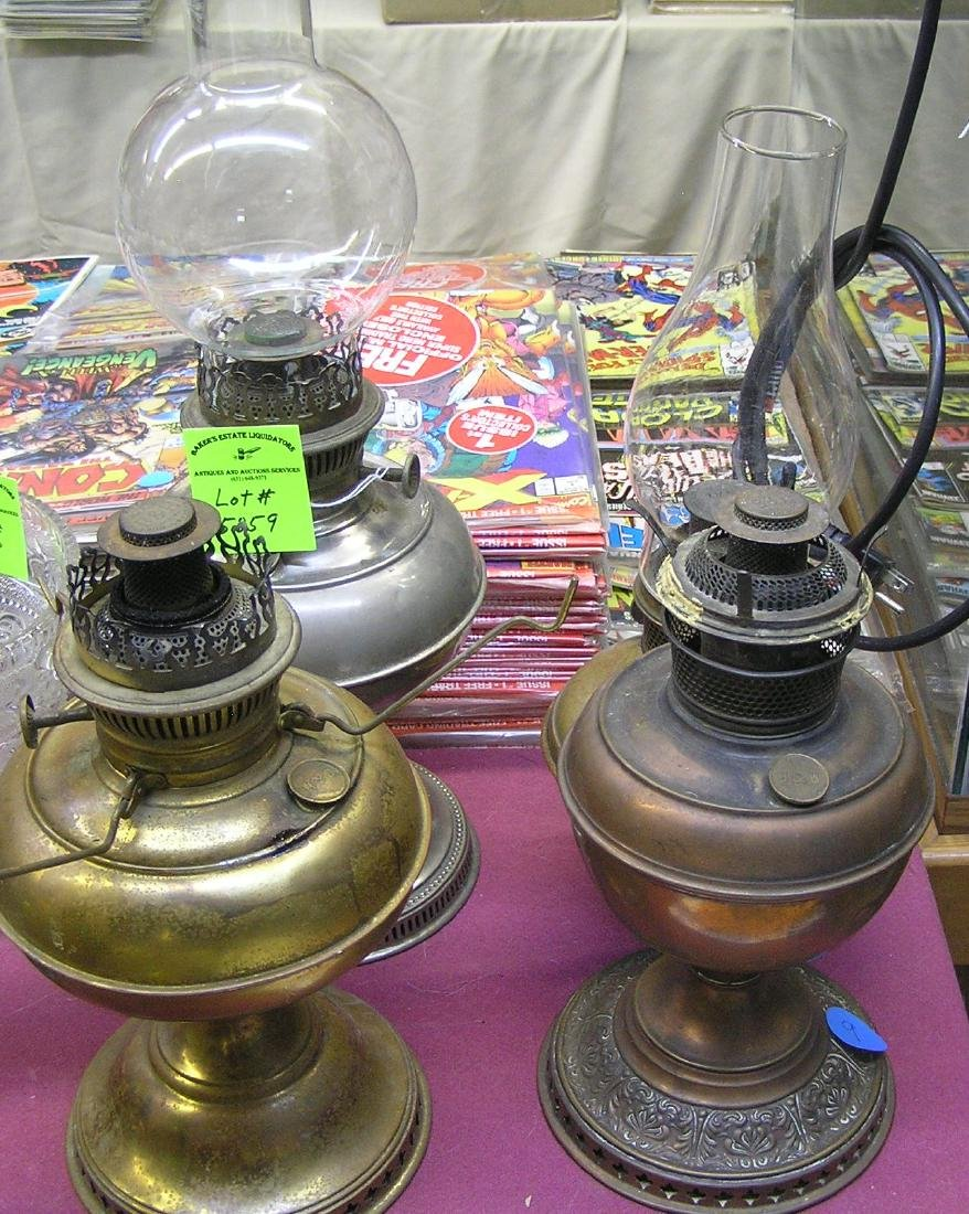 Group of four antique brass and copper oil lamps
