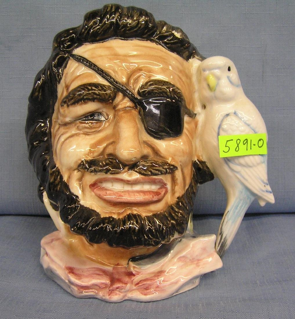 Figural Buccaneer and parrot mug