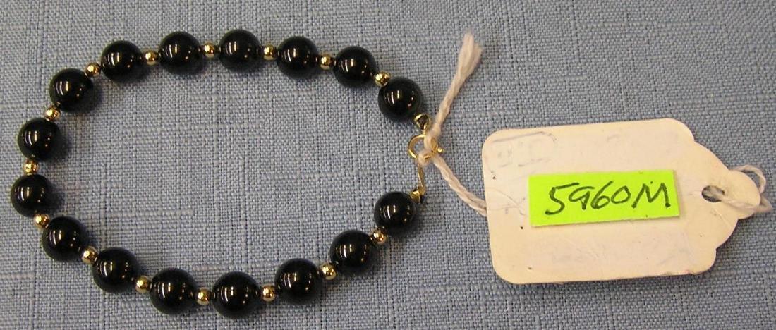 14 kt gold and onyx bracelet