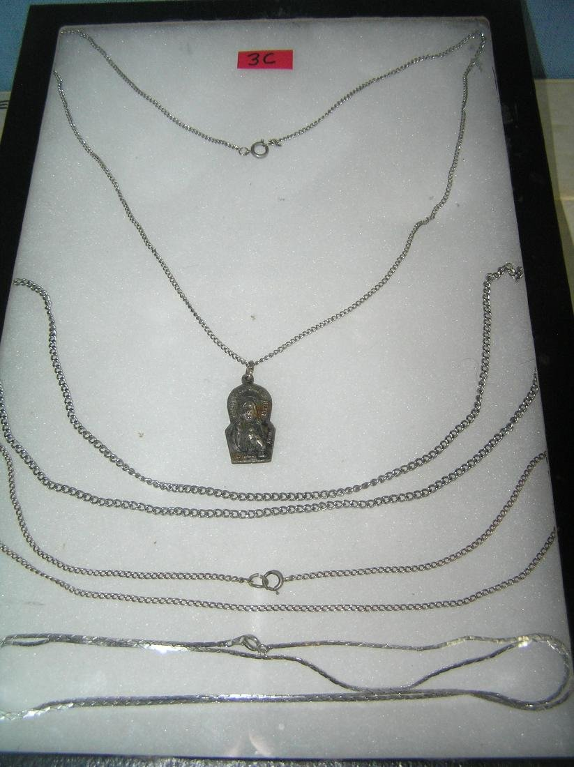 Group of silver and silver plated necklaces