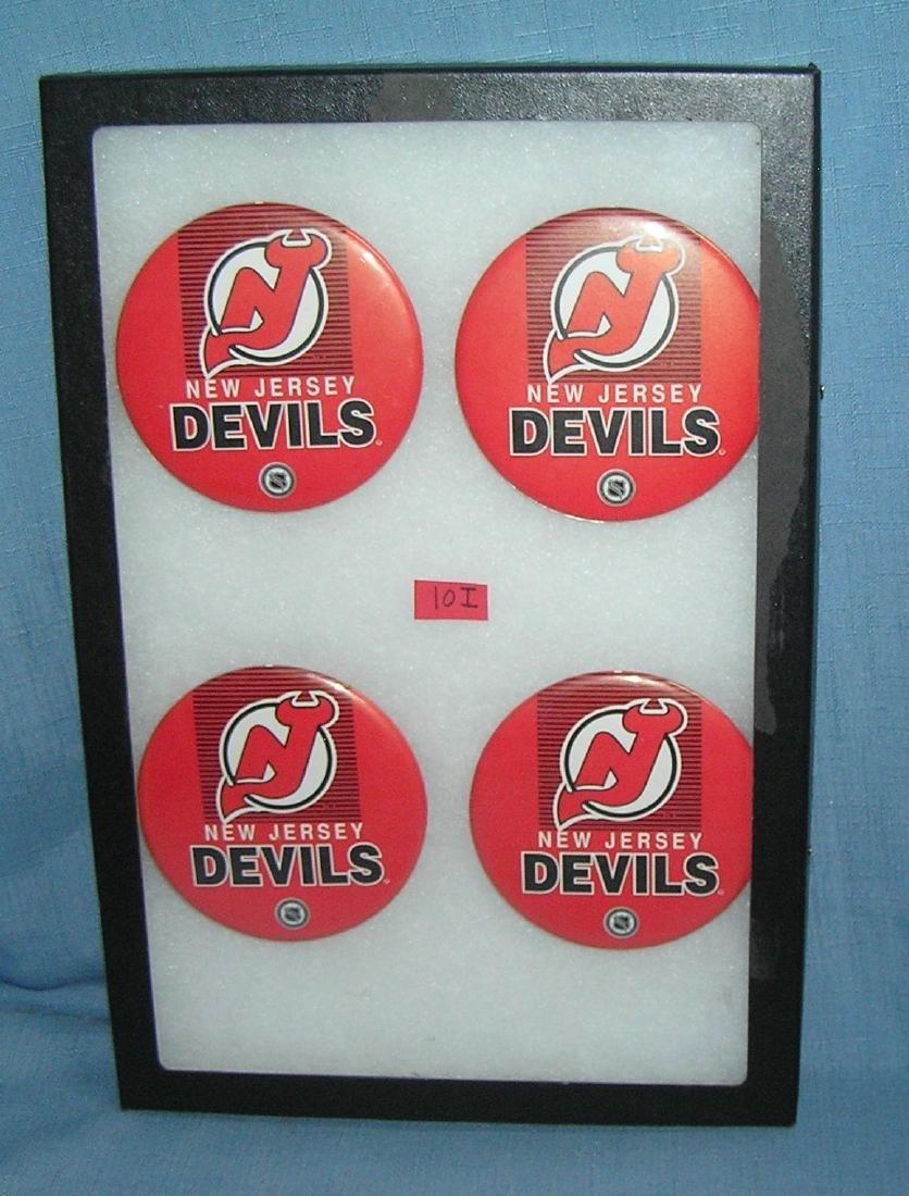 Group of vintage NHL NJ Devils hockey pin back buttons