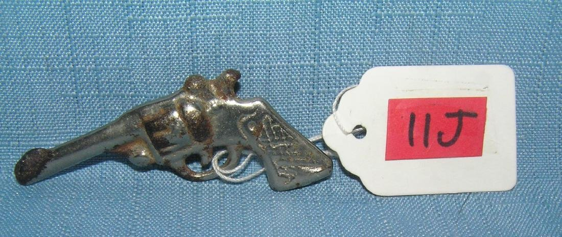 Early cast iron miniature toy gun